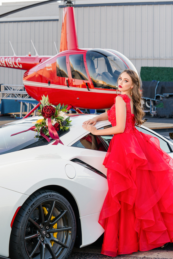Bride with helicopter and luxury car